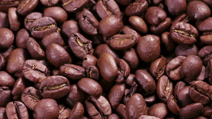 close up footage of rotating roasted coffee beans, hight detaile