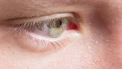 female teen eye close up, reading or watching something