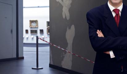 Man standing inside museum interior