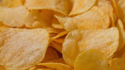 closeup potato chips rotating loopable footage, shot in RAW