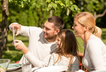happy family with tablet pc outdoors