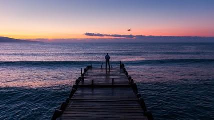 Black sea at dawn with pier