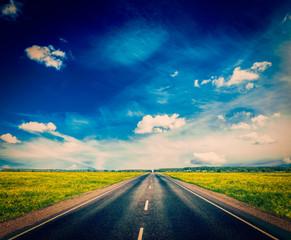 Road in blooming spring meadow
