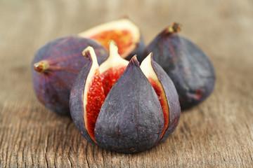 Ripe sweet figs on wooden background