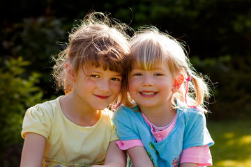 Two young friendly girls in the garden