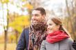 smiling couple hugging on bridge in autumn park