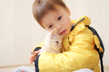 Boy with little cat