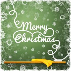 Merry christmas message, written on the green school chalkboard