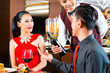 Young Asian couple drinking wine in restaurant