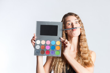 Woman put make-up on having fun