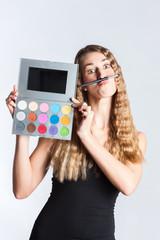 Woman put make-up on having fun