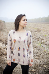 brunette girl looking the horizon in the countryside