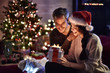Leinwanddruck Bild - portrait of a young couple in their living room in  christmas ev