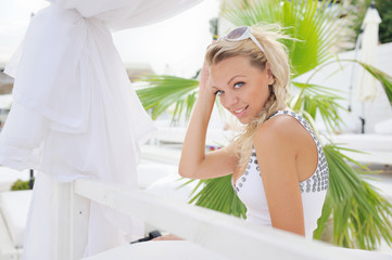 Woman portrait on a lounger in sea beach club.