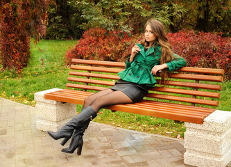Girl sitting on a bench in the park.