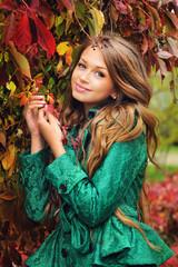 Portrait of a cute girl in green jacket.