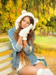 Portrait of a cute girl in a bear hat.