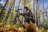 crouching bow hunter