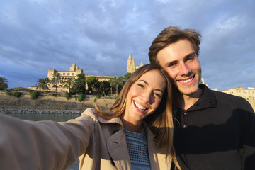 Tourist couple on holidays photographing a selfie