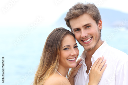 Happy couple with a white smile looking at camera - 72695544