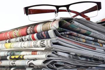 Eyeglasses and Newspapers