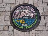 Manhole drain cover on the street at Kawaguchiko lake, Japan