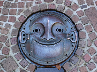 Manhole drain cover on the street at Ghibli museum, Japan