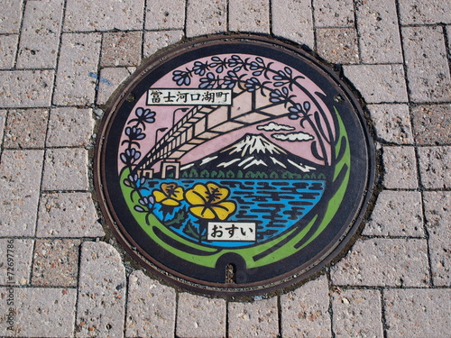 Foto op Aluminium Tunnel Manhole drain cover on the street at Kawaguchiko lake, Japan