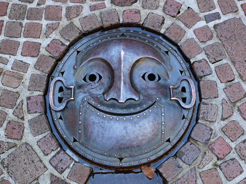 Fotobehang Tunnel Manhole drain cover on the street at Ghibli museum, Japan