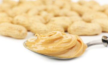 Creamy peanut butter in spoon, close-up
