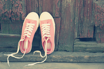 Sneakers on floor on wooden background