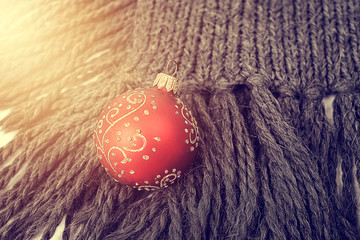Red bauble on a gray scarf - winter time!