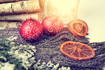 Climate Winter Christmas card with balls and dried oranges