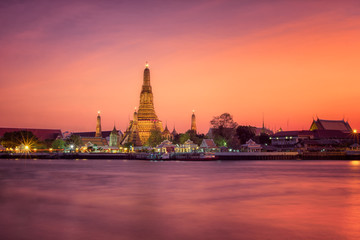 Wat arun main pagoda in sunset Bangkok Thailand