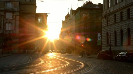 city - urban street with cars - sunrise - buildings