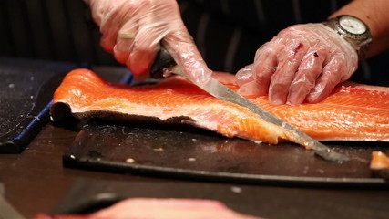 cleaning and slicing fish