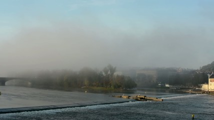 panorama city and river with morning mist - bridge and trees