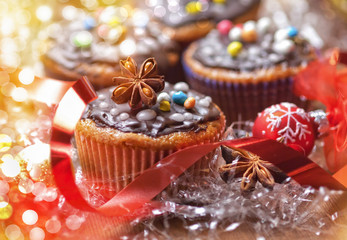 Decorated Christmas cupcakes on wooden table