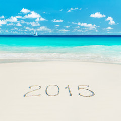 Yacht at tropical beach and 2015 happy new year sandy caption. S