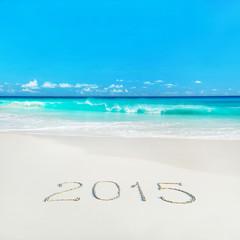 Happy New Year 2015 season concept on tropical sandy beach