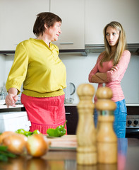 Mother with daughter at kitchen