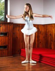 Young ballerina practicing in a dance studio