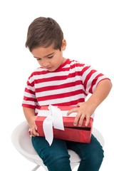 Cute little boy opening gift