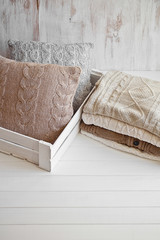 Cozy wool winter accessory. Warm sweaters and pillow