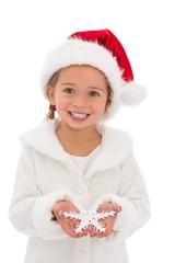 Festive little girl holding snowflake