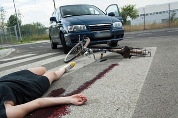 Casualty in blood on the road