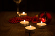 candles burning in the dark on the background of Christmas decor