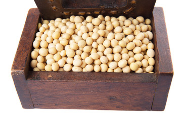 Soybean in wooden box over white background