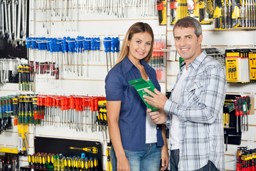 Couple Buying Product In Hardware Store