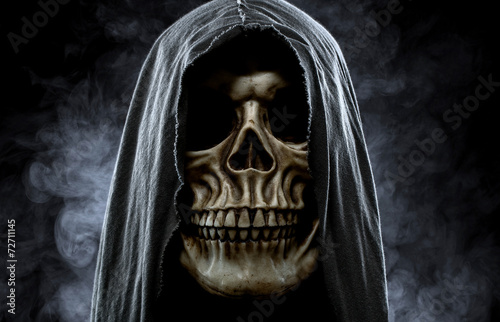 canvas print picture Grim reaper, portrait of a skull in the hood over black, foggy b